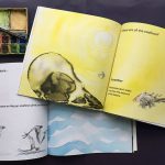 Pages with spiralling yellow sun, inky bird skull, blue water brush strokes alongside a paint box