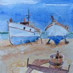 2 boats supported on the beach, painted against a blue sky