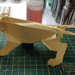 Sabre tooth cut out and folded from yellow card