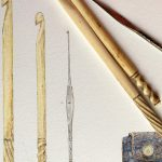 3 crotchet hooks, 2 are decoratively carved bone the smallest is metal. Shown as a photo and an accurate colour drawing.